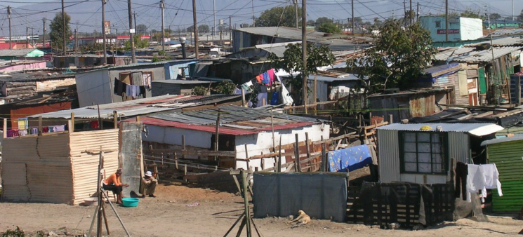 ... in impoverished South African township communities ...